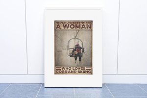 Never underestimate a woman who loves dogs and skiing poster11