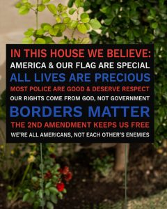 In this house we believe America and our flag are special most police are good and respect yard sign